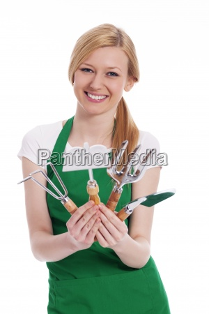 happy young woman with gardening equipment