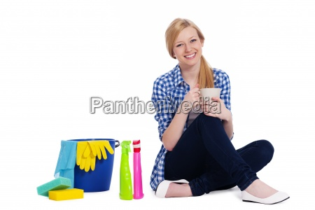 young woman relaxing after cleaning
