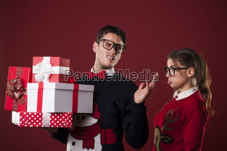 rude nerdy man with christmas gifts