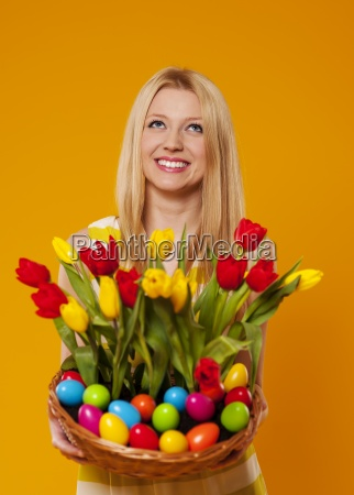 happy, woman, holding, basket, with, spring - 12116854