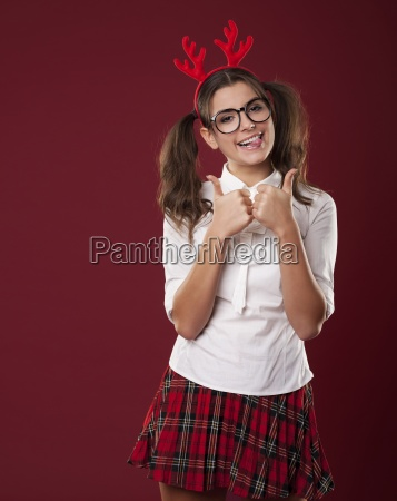 bizarre woman with christmas horns showing