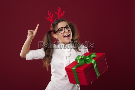 excited nerdy woman with red christmas
