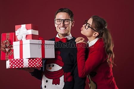 nerdy woman kissing her boyfriend in