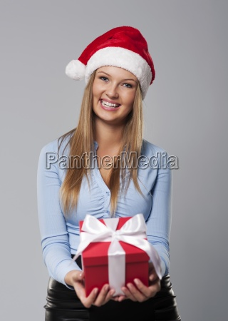 christmas business woman giving small gift