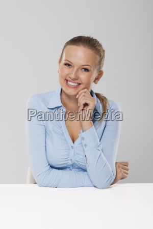 portrait of smiling and candid businesswoman
