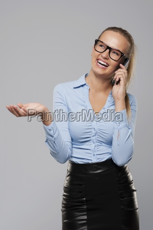 laughing businesswoman talking on mobile phone