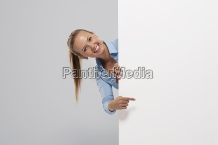 smiling beautiful businesswoman pointing at whiteboard