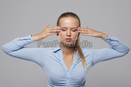 young businesswoman with bad headache