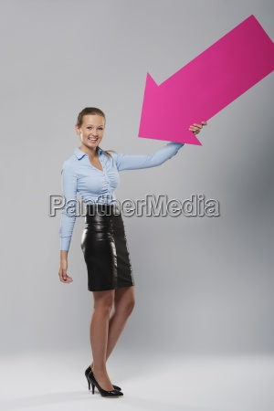 happy businesswoman with pink arrow
