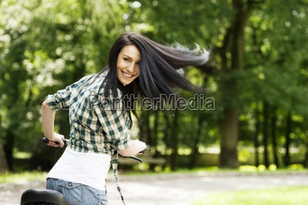 happy young woman with bike in