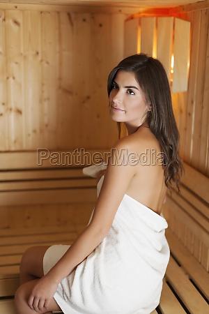 beautiful woman enjoying in sauna