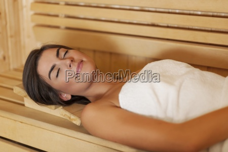 beauty young woman resting in sauna