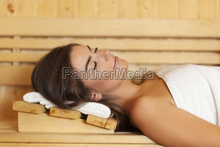 woman wrapped in white towel laying
