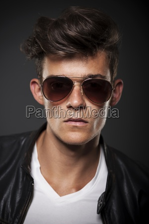 portrait of male model wearing sunglasses