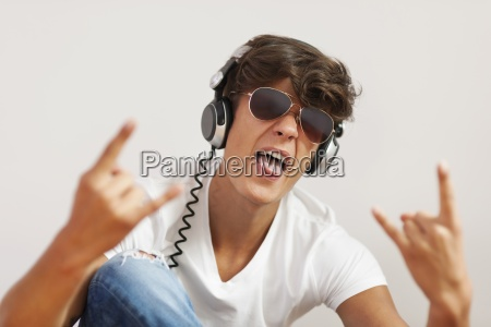 excited young man listening hard rock
