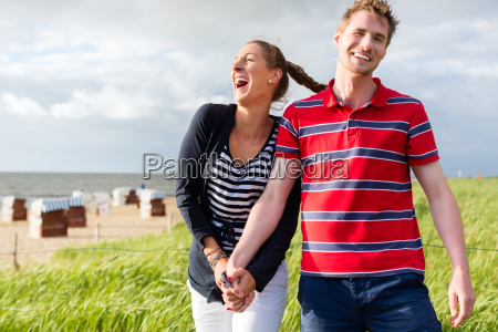 couple enjoying vacations in the beach