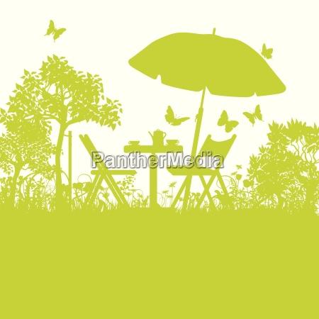 sedie da giardino con ombrellone in