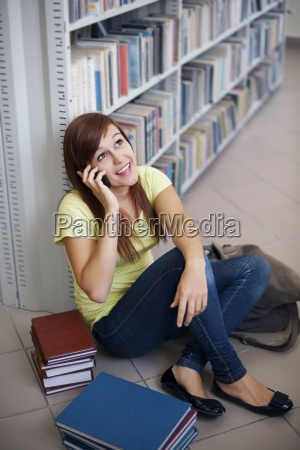 happy student on the phone in