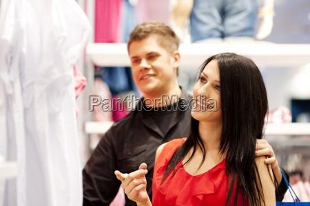 happy couple doing shopping