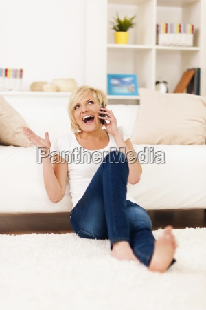 laughing woman on the phone in
