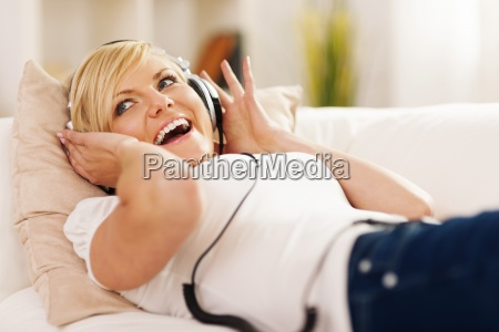 happy woman listening to music on