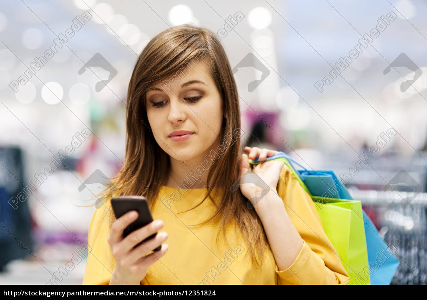 young, woman, texting, on, mobile, phone - 12351824