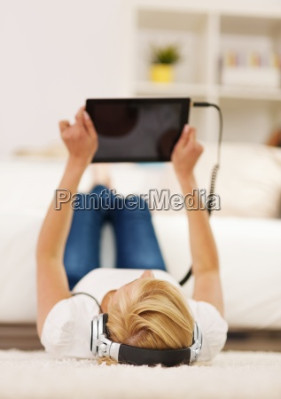 blonde woman listening to music