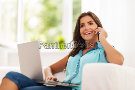 happy woman paying using laptop and