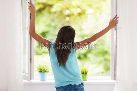 young woman breathing fresh air during