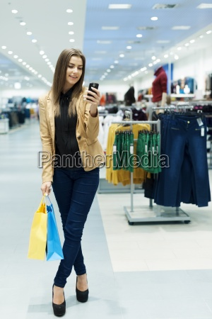 happy young woman using smartphone in