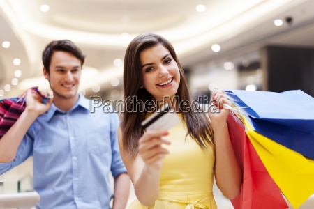 happy woman holding credit card and