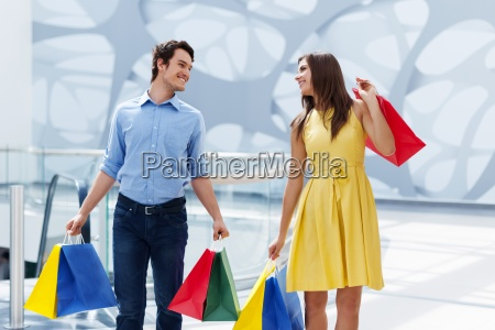 happy couple after successful shopping