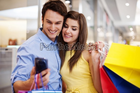 bonding couple looking at mobile phone