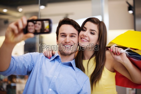 happy couple taking a photo in