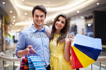 portrait of happy couple with shopping