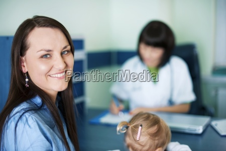 smiling mother with her child at