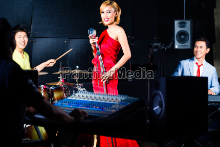 asian professional band in recording studio
