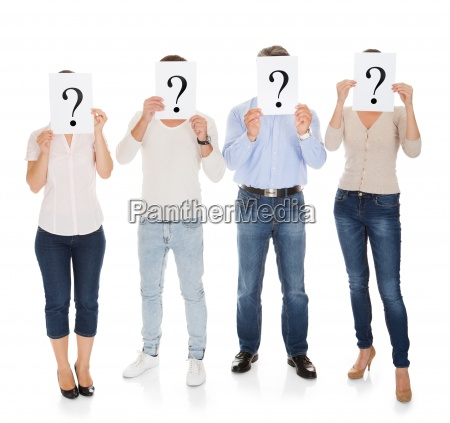group of a people holding question