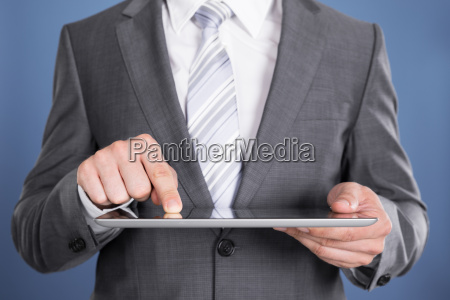 hand, pointing, at, tablet, computer, screen - 12541184