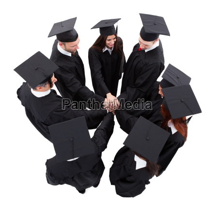 graduate students stacking hands