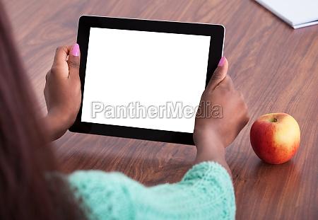 teacher using digital tablet at classroom