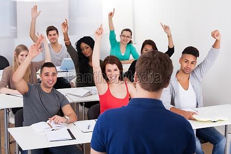 university students answering teacher