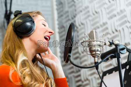 singer or musician in recording studio
