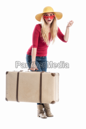 astonished woman with travel suitcase