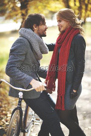 man on bike and his girlfriend