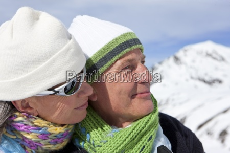 close up of smiling couple wearing