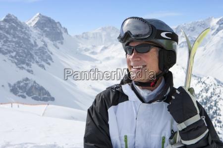 smiling senior man wearing sunglasses and