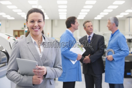 portrait of smiling engineer with digital