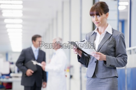 portrait of smiling businesswoman with paperwork