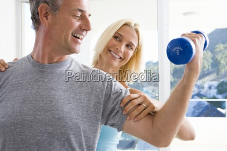 mature woman smiling at mature man